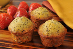 Poppyseed muffins with strawberries Royalty Free Stock Image