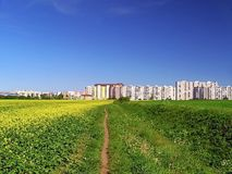 Poprad and coming across the fields to the house. Royalty Free Stock Image