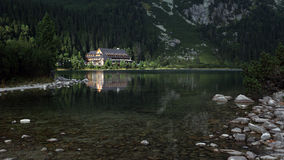 Popradske pleso , Vysoke Tatry , Slovakia. Hut by the mountain lake Popradske pleso is a popular hiking destination for visitors of National park Vysoke Tatry stock photos