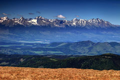 Poprad valley and highest peaks of High Tatras, Slovakia. Poprad valley with eastern part of High Tatra range in the background, including its highest summits Stock Photo