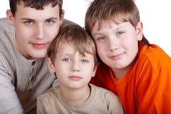 Poprtrait de plan rapproché de trois garçons Photographie stock