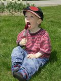 Popsicle boy. Boy eating a popsicle outside Royalty Free Stock Images