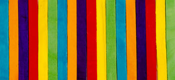 Popsicle Sticks in Line. A Rainbow of Colorful Popsicle Sticks in Line royalty free stock photography
