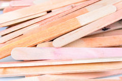 Popsicle Sticks. Shot of a pile of popsicle sticks isolated over white royalty free stock photography