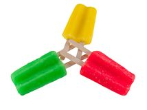 Popsicle trio on white. Isolated image of red, green, yellow popsicles Royalty Free Stock Photography
