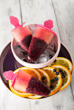 Popsicles with blueberries and orange. Homemade iсе cream popsicle  with blueberries and orange Royalty Free Stock Photos