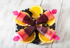 Popsicles with blueberries and orange. Homemade iсе cream popsicle  with blueberries and orange Royalty Free Stock Photography