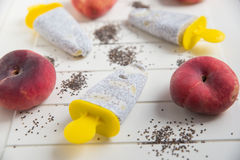 Popsicles with chia seeds and peach Stock Photography
