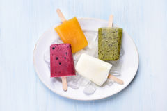 Popsicles from fruits, top view Royalty Free Stock Images
