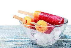 Popsicles on a plate with ice isolated Royalty Free Stock Photo