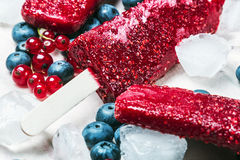 Popsicles with red currants and blueberries. Homemade popsicles with red currants and blueberries Royalty Free Stock Image