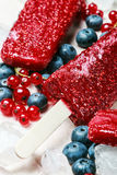 Popsicles with red currants and blueberries. Homemade popsicles with red currants and blueberries Royalty Free Stock Images