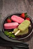 Popslices icecream  assortment on dark background Royalty Free Stock Photos