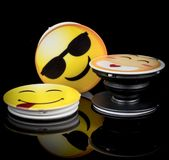 Popsockets with Emoji pictures on black background. Popsockets with Emoji pictures or car logos on black background. They help holding your smartphone or use stock photography