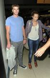 Popstar Miley Cyrus is seen with boyfriend at LAX Royalty Free Stock Image