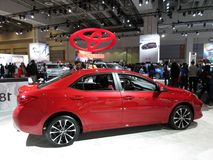 Populair Rood Toyota Corolla stock afbeelding