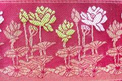 Populaire het patroonachtergrond van batiksarongen in traditioneel Thailand, stock foto