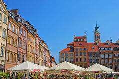 Popular Al Fresco Dining during Summer Time at Warsaw Old Town Market Place. Popular Al Fresco Dining with big umbrella sponsored by Zywiec Brewery during Summer royalty free stock photos