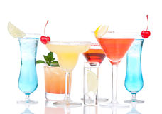 Popular alcoholic cocktails drinks yellow margarita cherry blue Royalty Free Stock Photos