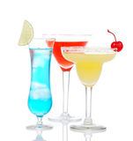 Popular alcoholic cocktails drinks yellow margarita cherry blue Royalty Free Stock Photo