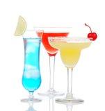 Popular alcoholic cocktails drinks yellow margarita cherry blue Royalty Free Stock Photo