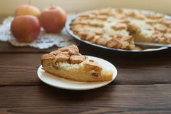Popular American apple pie piece and cup of tea on wooden table background. Homemade classical friut tart, Piece of apple pie. Close up royalty free stock photos