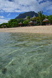 Popular Beach Resort at Le Morne, Mauritius with very clear water and Le Morne Brabant Mountain in the background Stock Image