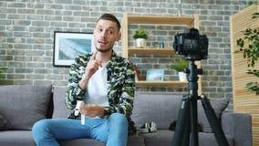 Popular blogger advertising modern watch recording video talking for camera. Popular blogger handsome guy is advertising modern watch recording video talking for stock video footage