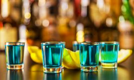 Popular blue drink shot kamikaze on the background of the bar wi Royalty Free Stock Photo