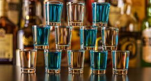 Popular blue drink shot kamikaze on the background of the bar wi Royalty Free Stock Image