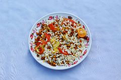 Popular breakfast chick-pea with tomato mixture and mudhi royalty free stock images