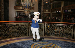Popular Cartoon Character Mickey Mouse. ORLANDO, FL - FEB 3:  Popular Cartoon Character Mickey Mouse signing autograph before a presentation of Walt Disney Stock Images