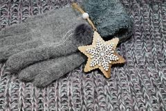 The popular Christmas gift for a woman - a woolen scarf and gloves. Christmas presents Royalty Free Stock Images