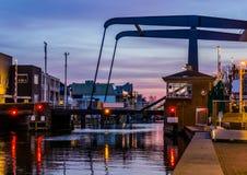 The popular city bridge alphensebrug in Alphen aan den Rijn, the Netherlands, beautiful water scenery at sunset stock image