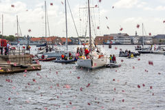 Popular danish sailing boat back after circumnavigation. People greeting popular sailing boat after circumnavigation Stock Images