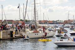 Popular danish sailing boat back after circumnavigation. People greeting popular sailing boat after circumnavigation Stock Photos