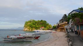 Sabang beach during a cloudy evening in the Philippines. The popular dive tourist hotspot Sabang Beach, in the Philippines stock video