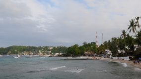 Sabang beach during a cloudy evening in the Philippines. The popular dive tourist hotspot Sabang Beach, in the Philippines stock video footage