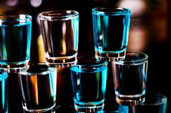 Popular drink shot kamikaze based on vodka, blue curacao and lem. On juice, refreshing drink, party night Stock Image