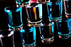 Popular drink shot kamikaze based on vodka, blue curacao and lemon juice, refreshing drink. Party night stock images