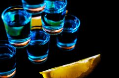 Popular drink shot kamikaze based on vodka, blue curacao and lemon juice, refreshing drink. Party night royalty free stock image