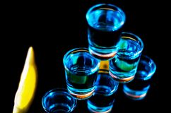 Popular drink shot kamikaze based on vodka, blue curacao and lem. On juice, refreshing drink, party night Royalty Free Stock Images