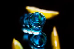 Popular drink shot kamikaze based on vodka, blue curacao and lem. On juice, refreshing drink, party night Stock Photography