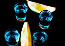 Popular drink shot kamikaze based on vodka, blue curacao and lem Royalty Free Stock Photo
