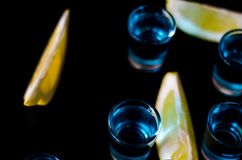 Popular drink shot kamikaze based on vodka, blue curacao and lemon juice, refreshing drink. Party night royalty free stock photo