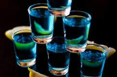 Popular drink shot kamikaze based on vodka, blue curacao and lem. On juice, refreshing drink, party night Royalty Free Stock Photos