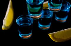 Popular drink shot kamikaze based on vodka, blue curacao and lemon juice, refreshing drink. Party night royalty free stock photos