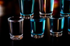 Popular drink shot kamikaze based on vodka, blue curacao and lemon juice, refreshing drink. Party night stock photo