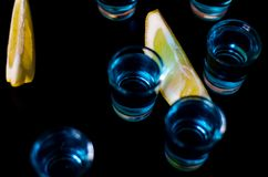 Popular drink shot kamikaze based on vodka, blue curacao and lemon juice, refreshing drink. Party night stock photos