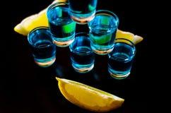 Popular drink shot kamikaze based on vodka, blue curacao and lem. On juice, refreshing drink, party night Stock Images